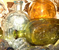 Glass Eagle Flasks. Homage to 19th century eagle and shield glass bottles at flea market Royalty Free Stock Image