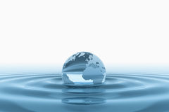 Glass earth globe in water Royalty Free Stock Photography