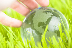 Glass earth in grass Stock Photo