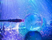 Glass earth with network against fiber optic Royalty Free Stock Photos