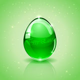 Glass Easter egg on green background Stock Image