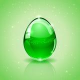 Glass Easter egg on green background Stock Image