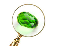 The Glass Easter egg under Magnifier. Isolated Stock Photos