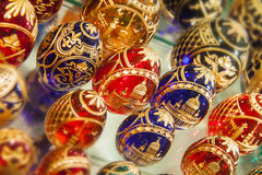 Glass easter eggs. A lot of varicoloured glass easter eggs on the shelf Stock Photo