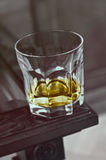 Glass on a edge of bar Royalty Free Stock Photos