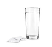 Glass with effervescent tablet . Royalty Free Stock Photos