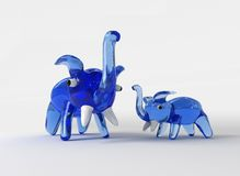 Glass elephants. Two glass elephants on a white background Stock Photography