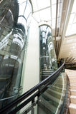 Glass elevator. Glass tubular elevator in modern building Stock Image