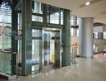 Glass elevator. Glass tubular elevator in modern building Royalty Free Stock Image