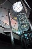 Glass elevator. In modern train station Stock Photos