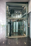 Glass elevator at airport terminal Royalty Free Stock Image