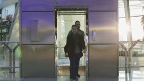 Glass elevator car rises. stock video footage