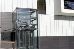 The glass elevator. The city glass made elevator Stock Photo