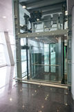 Glass elevator for disabled people at international airport Royalty Free Stock Photos