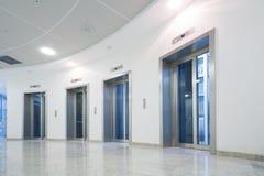 Glass elevator door in the business building. Four glass elevator door in the business building Stock Photos