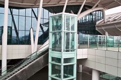 Glass elevator and escalator. At the railway station Royalty Free Stock Images