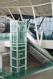 Glass elevator and escalator. At the railway station Stock Photo