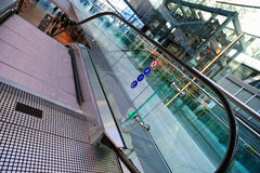 Glass elevator and escalator in Frankfurt airport Royalty Free Stock Image