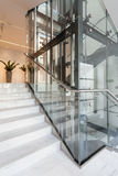 Glass elevator in modern building Stock Image
