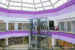 The glass elevator in the modern shopping center Royalty Free Stock Image
