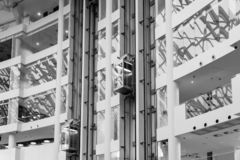 Glass Elevator in office building in black and white color, elev stock images