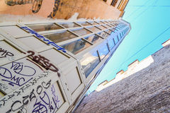 A glass Elevator. On the outside of the house. The Elevator outside the building. The Elevator made of glass. Transparent Elevator. Graffiti on the Elevator Royalty Free Stock Images