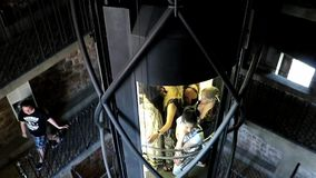 Glass elevator rides with tourists stock video