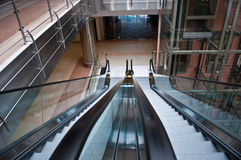 Glass elevator shaft. In a modern office building Royalty Free Stock Photography