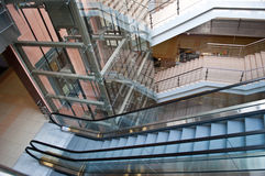 Glass elevator shaft. In a modern office building Stock Photos