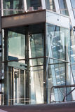 Glass elevator shaft in a modern building. In the Netherlands Royalty Free Stock Photo