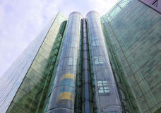 Glass elevator. Glass tubular elevator in modern building Royalty Free Stock Images