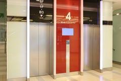 Glass elevator. Glass tubular elevator in modern building Royalty Free Stock Photography