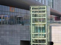 Glass elevator. Glass tubular elevator in modern building Stock Photo