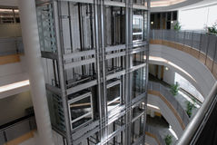 Glass elevators Stock Photos