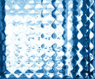 Glass embossed pattern in blue tones. Glass relief. Royalty Free Stock Image