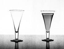 Glass empty and full Stock Images