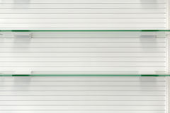 Glass empty shelves Royalty Free Stock Images