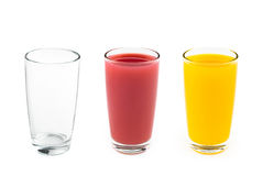 Glass empty with two glasses juice. Glass empty with two juice on white background Stock Images
