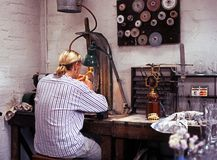 Glass Engraver in workshop. Stock Photo