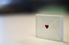 Glass envelope with a heart Stock Images