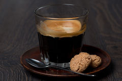 Glass of espresso and almond cookies Stock Photography