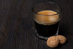 Glass of espresso and almond cookies, close-up Stock Photos