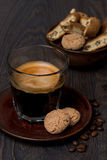 Glass of espresso and almond cookies, vertical Royalty Free Stock Image