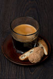 Glass of espresso, biscotti and almond cookies Stock Image