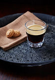 Glass of Espresso with Biscotti Stock Image