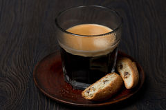 Glass of espresso and biscotti with raisins Stock Images