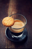Glass of espresso with biscuit Royalty Free Stock Images