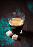 Glass of espresso and brown sugar Royalty Free Stock Images