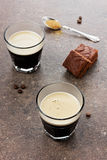 Glass of espresso with chocolate cake. On a vintage surface Stock Photography