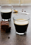 Glass of espresso with chocolate cake. On a vintage shabby surface Stock Photography